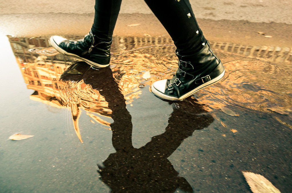 Reflection of city in a puddle